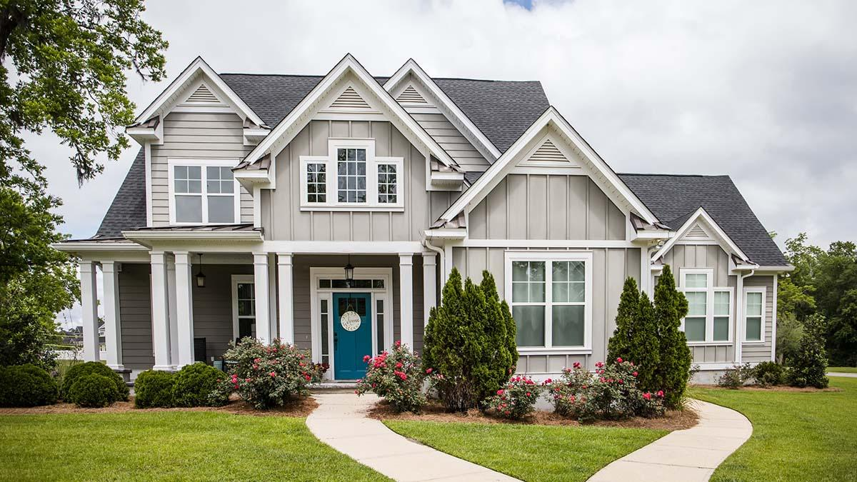 Beautiful home with flower beds