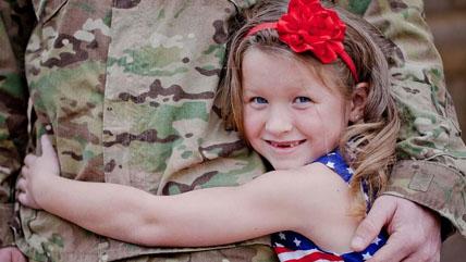 Veteran with daughter hugging