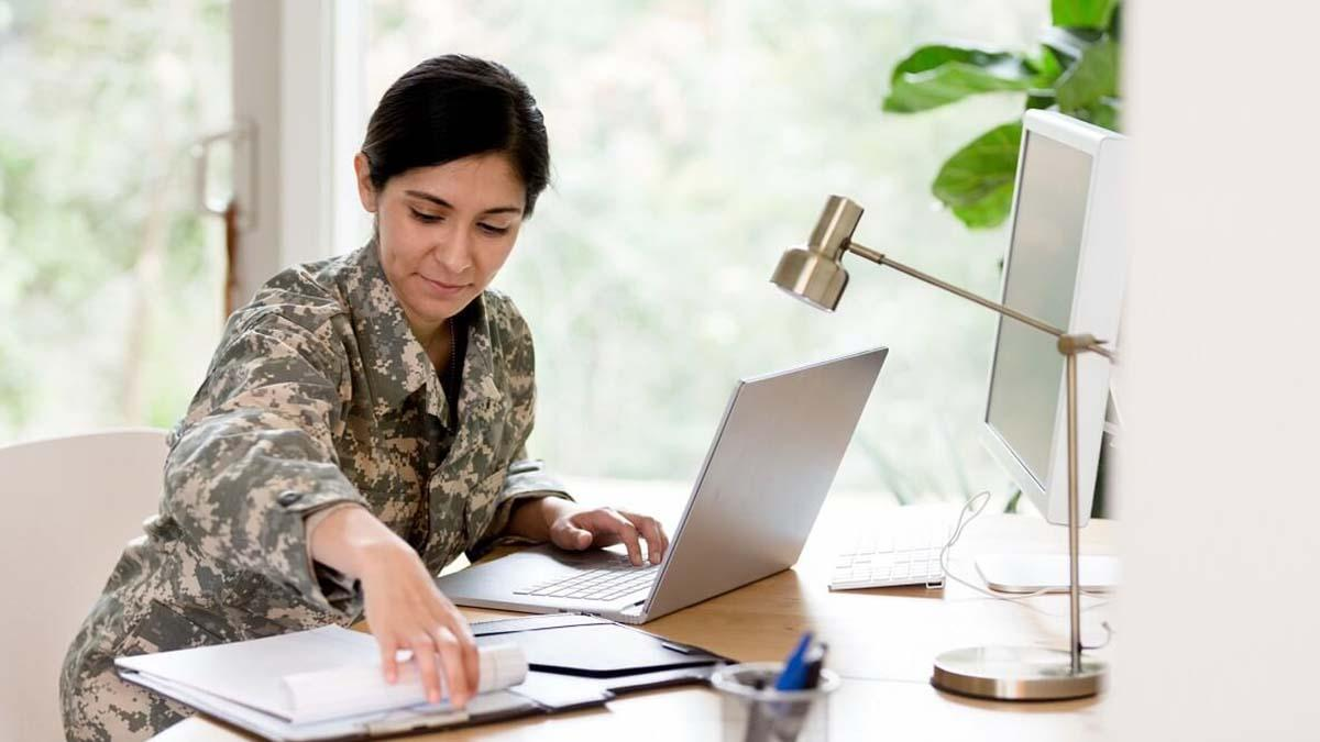 Woman veteran doing loan paperwork