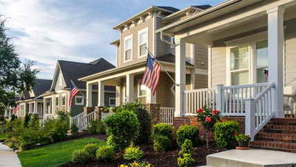 Houses in a row with American flags flying