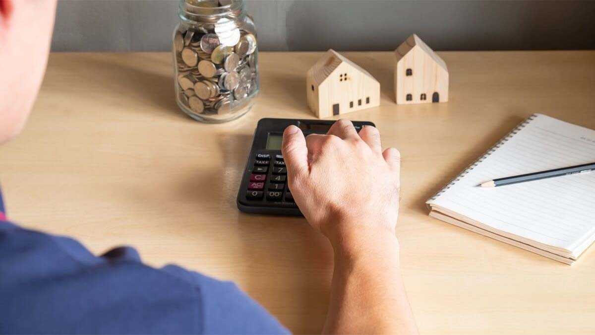 Homeowner sitting at desk and refinancing