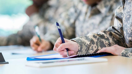 A group of veterans fill out paperwork