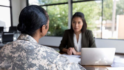 female veteran talking to another woman about allowable fees
