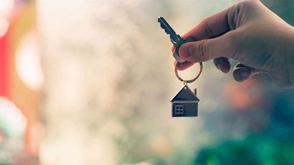 keys to a property in a person's hand