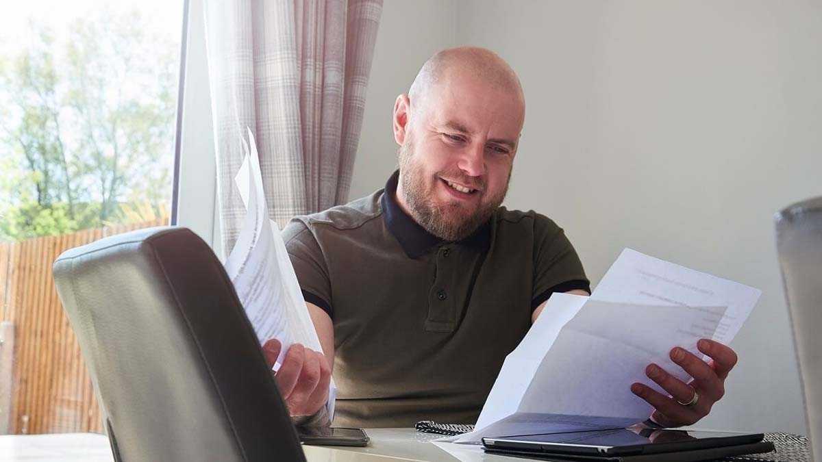 Homeowner looking through refinancing paperwork