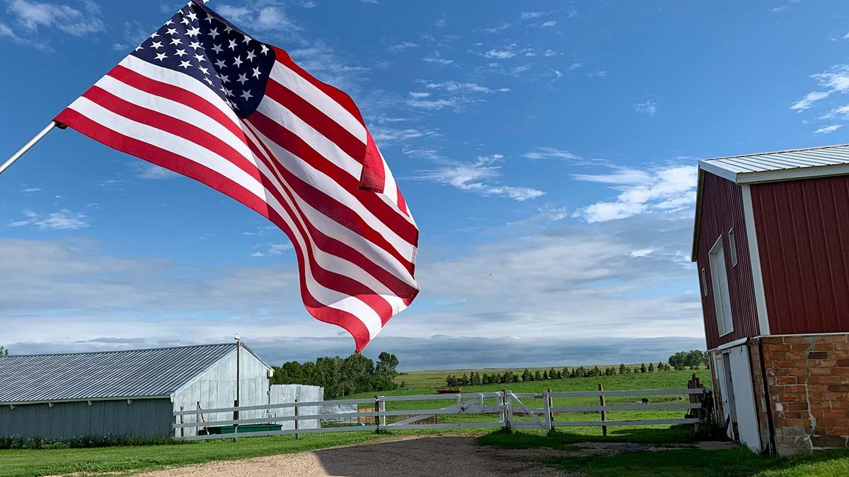 american flag flying for veterans in rural area