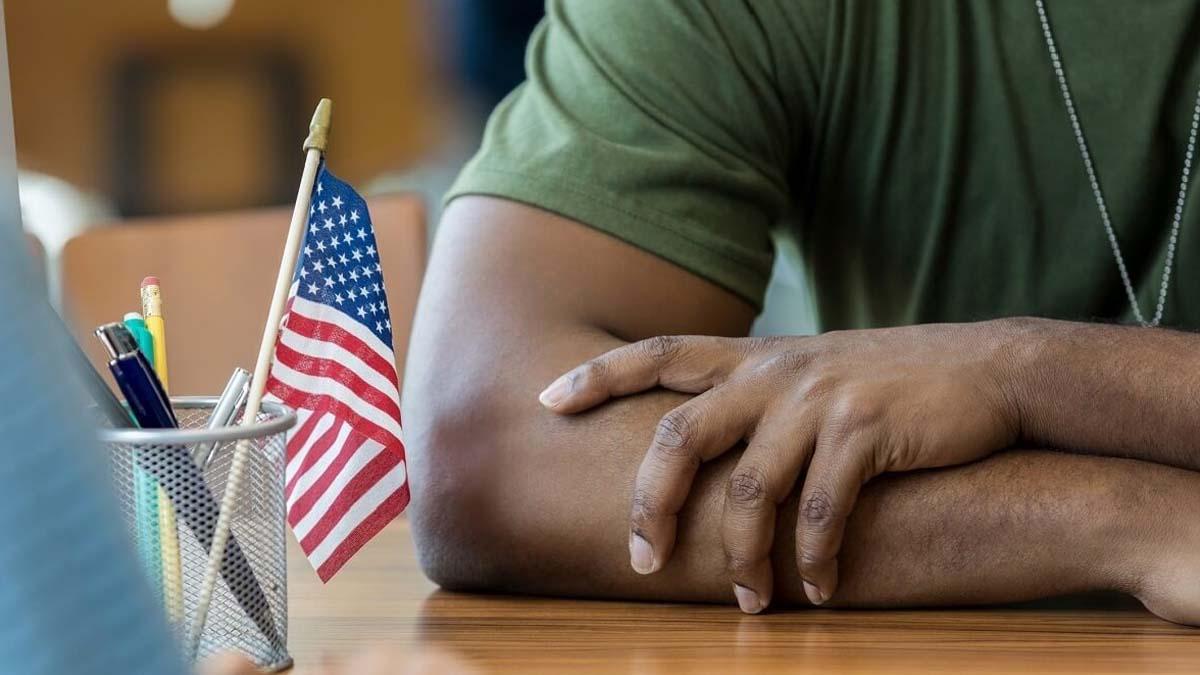 Close up of veteran seated at desk