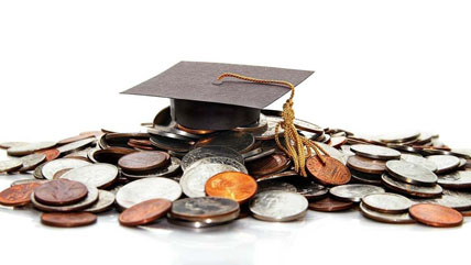 Stack of coins with a graduation cap to represent student loans